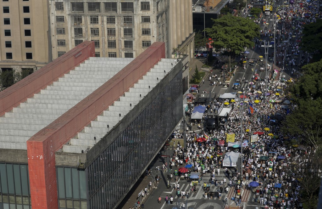 People gather next to the Art Museum during a protest against Brazilian President Jair Bolsonaro, at Avenida Paulista, Sao Paulo, Brazil, Sunday, Sep....