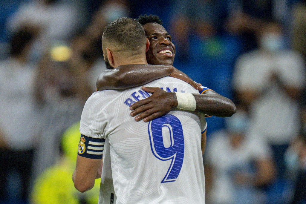 Real Madrid's Karim Benzema celebrates with his teammate Real Madrid's Vinicius Junior after scoring a penalty kick during the Spanish La Liga soccer ...