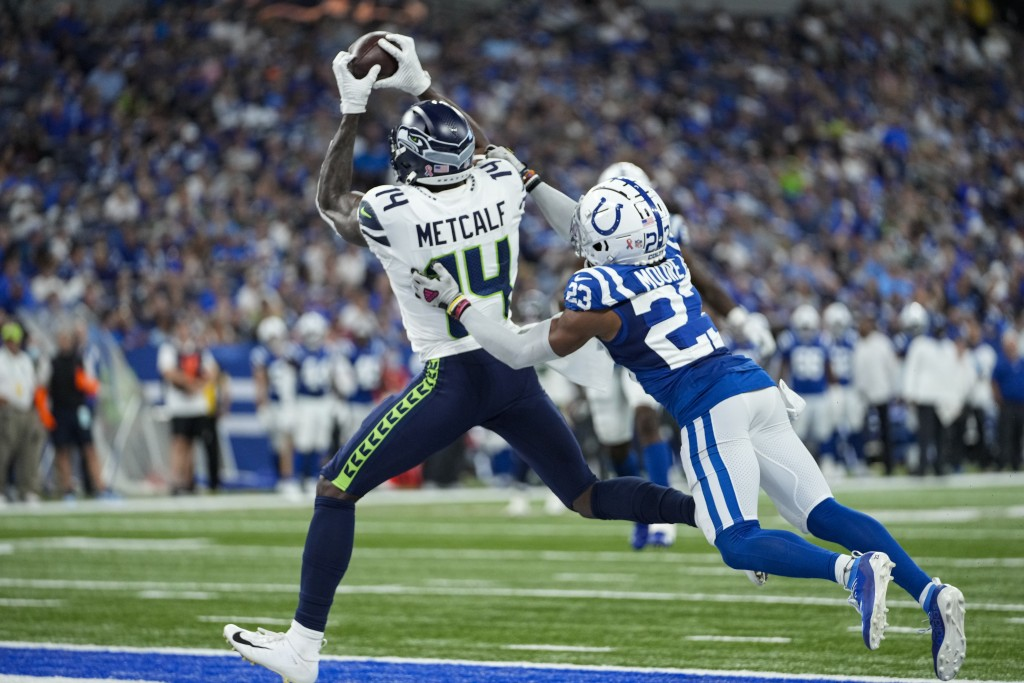 Seattle Seahawks wide receiver DK Metcalf (14) makes a catch in front of Indianapolis Colts cornerback Kenny Moore II (23) for a touchdown during the ...