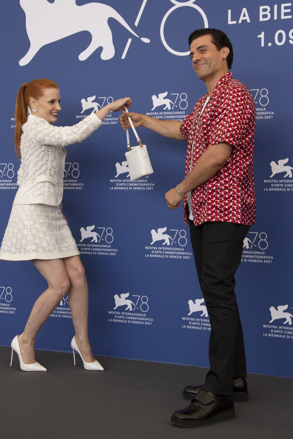 FILE - In this Sept, 4, 2021 file photo Oscar Isaac, right, and Jessica Chastain pose for photographers at the photo call for the film 'Scenes of a Ma...