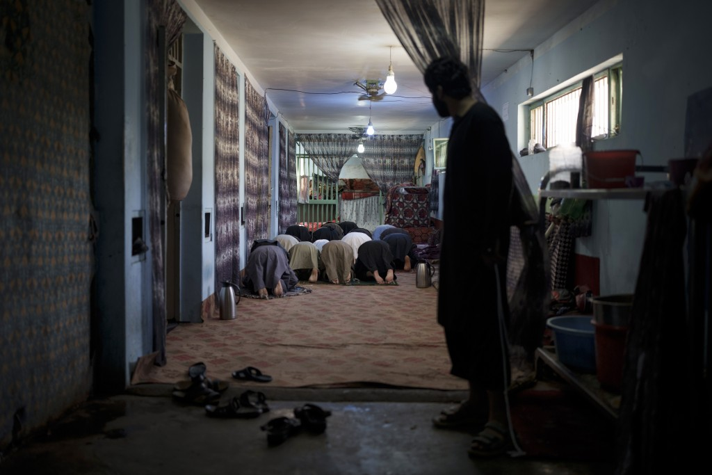 Recently arrested prisoners pray inside the Pul-e-Charkhi prison in Kabul, Afghanistan, Monday, Sept. 13, 2021. Pul-e-Charkhi was previously the main ...