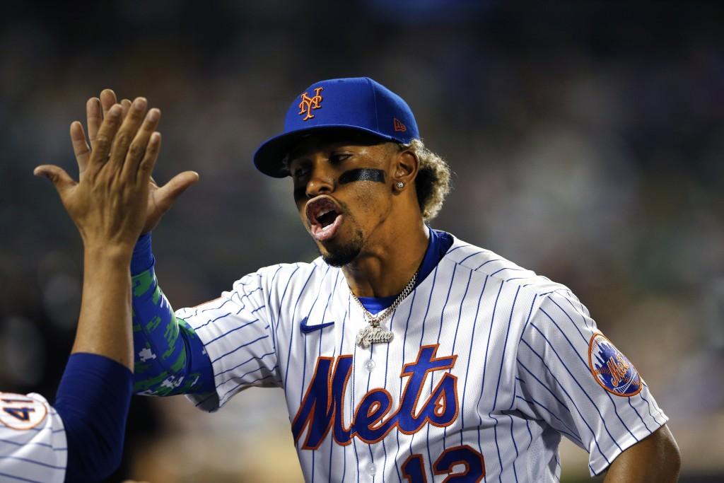 New York Mets' Francisco Lindor (12) reacts after completing a double play against the New York Yankees during the fifth inning of a baseball game on ...