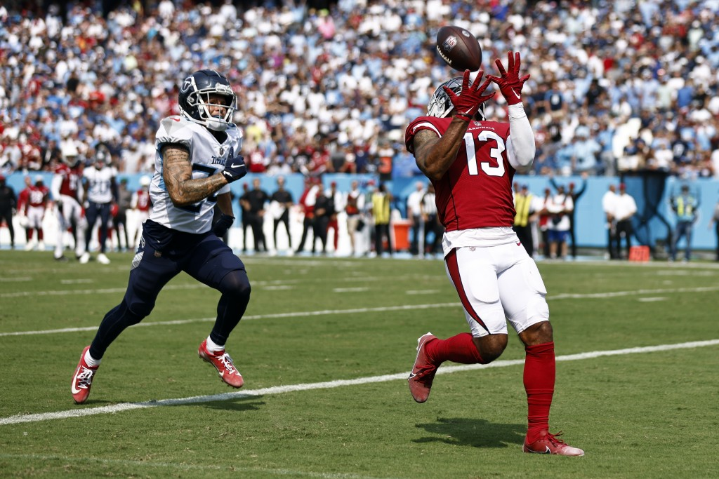 Arizona Cardinals wide receiver Christian Kirk (13) catches a 26-yard touchdown pass ahead of Tennessee Titans cornerback Elijah Molden, left, in the ...