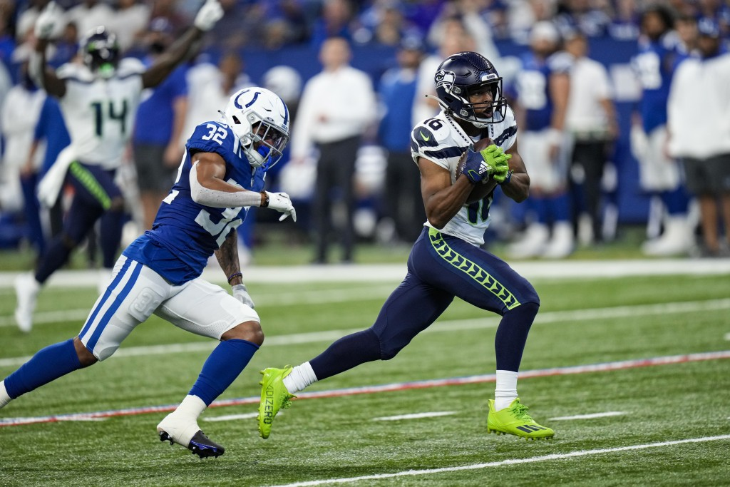 Seattle Seahawks wide receiver Tyler Lockett (16) makes catch in front of Indianapolis Colts safety Julian Blackmon (32) on his way to a touchdown dur...