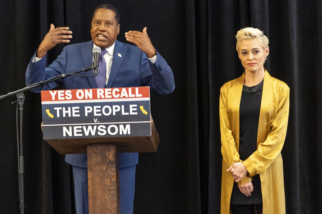 Republican conservative radio talk show host Larry Elder with former actress and activist Rose McGowan hold a news conference at the Luxe Hotel Sunset...