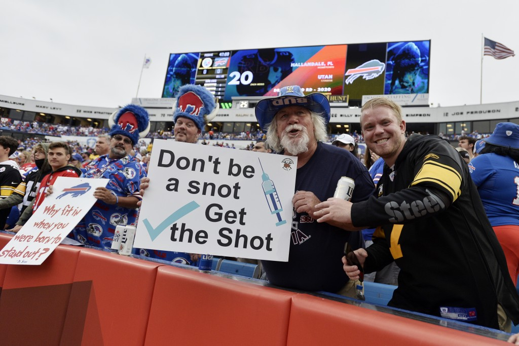 Fans holds signs during the first half of an NFL football game between the Buffalo Bills and the Pittsburgh Steelers in Orchard Park, N.Y., Sunday, Se...