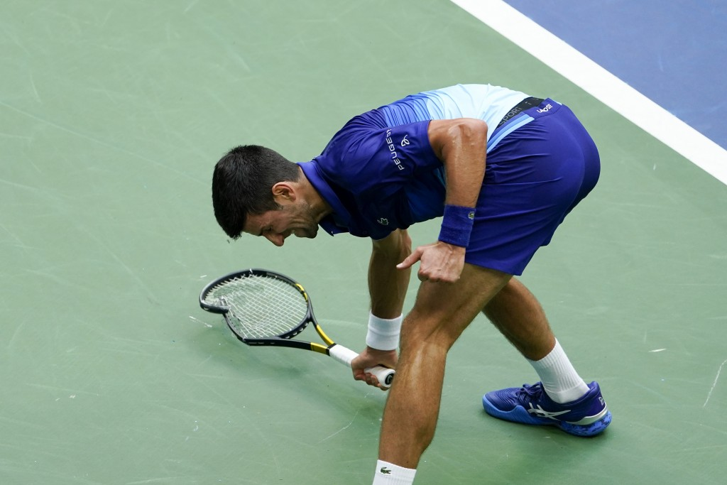 Novak Djokovic, of Serbia, smashes his racket on the court after losing a point to Daniil Medvedev, of Russia, during the men's singles final of the U...