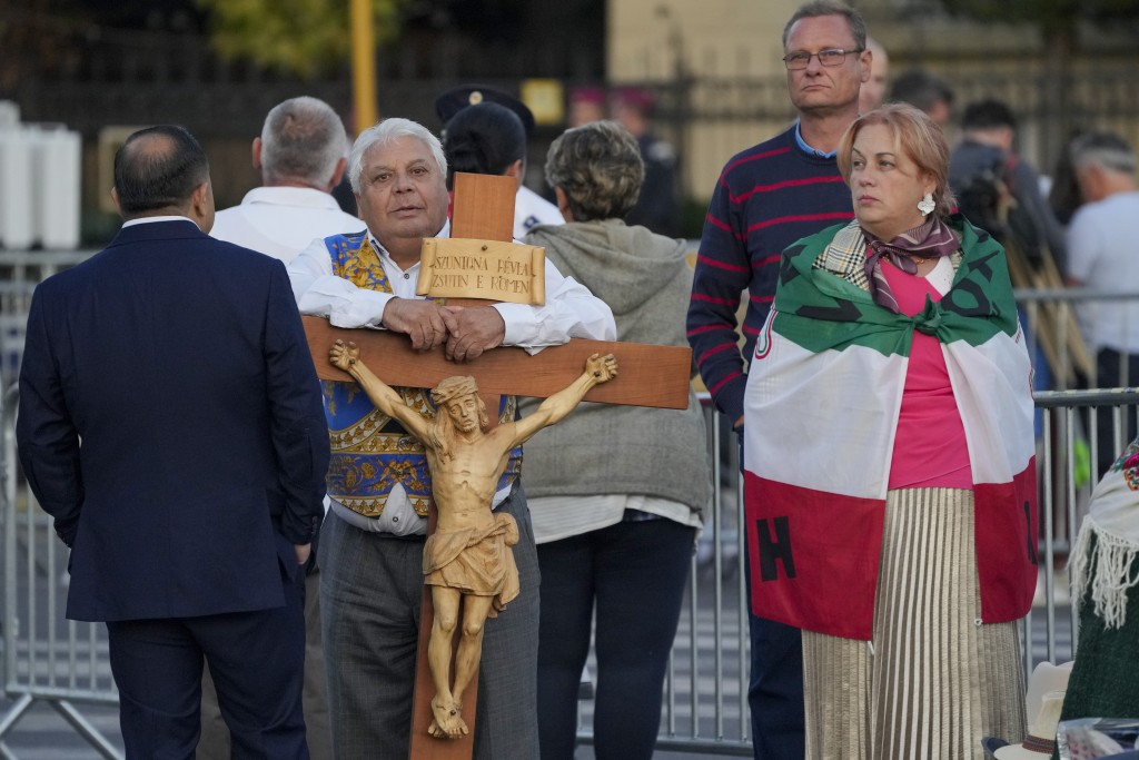 People wait for the arrival of Pope Francis to celebrate mass in Heroes' Square, Budapest, Sunday, Sept. 12, 2021. Francis is opening his first foreig...
