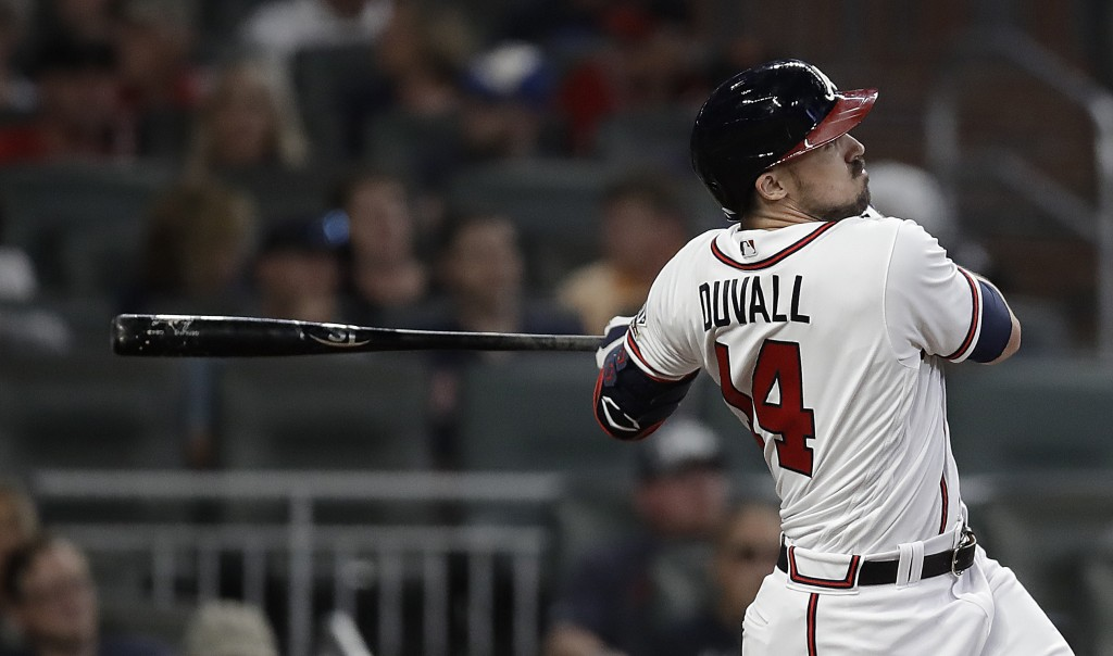 Atlanta Braves' Adam Duvall watches his home run against the Washington National during the eighth inning of a baseball game Thursday, Sept. 9, 2021, ...