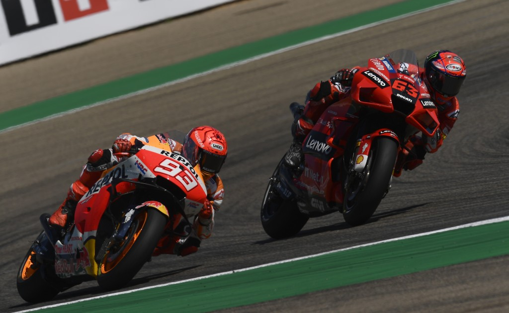 Francesco Bagnaia of Italy, (63), on his Ducati leads Marc Marquez of Spain during the Alcaniz Aragon Moto GP race at the MotorLand Aragon circuit, in...
