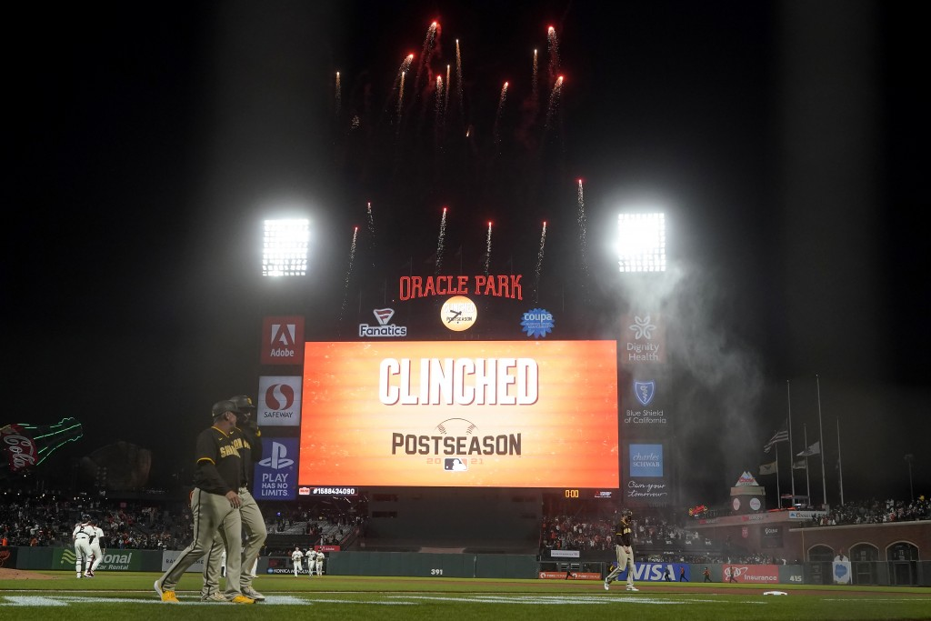 Fireworks go off behind the scoreboard at Oracle Park after the San Francisco Giants defeated the San Diego Padres in a baseball game to clinch a post...