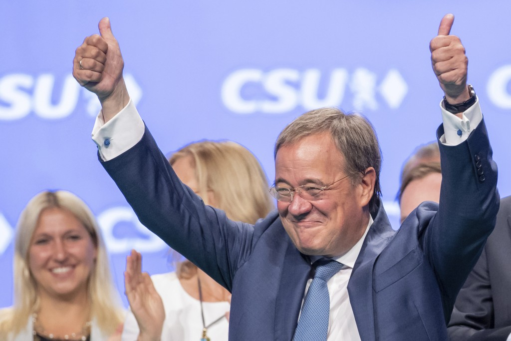FILE - In this Sept. 11, 2021 file photo, Armin Laschet, CDU/CSU candidate for chancellor, stands on stage after his speech at the CSU party conferenc...