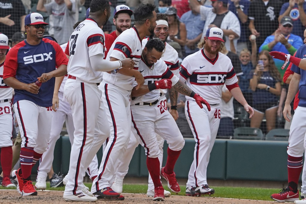 Chicago White Sox's Leury Garcia (28) celebrates his walk-off home run during the ninth inning against the Boston Red Sox of a baseball game, Sunday, ...