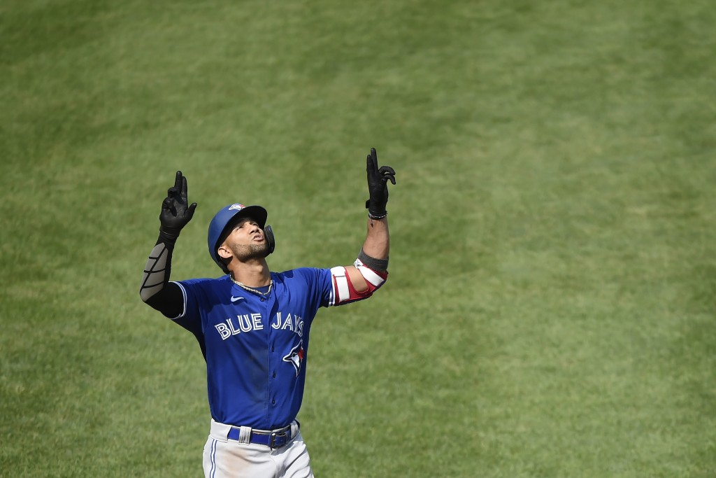 Toronto Blue Jays' Lourdes Gurriel Jr. reacts after hitting his second home run against the Baltimore Orioles, this one in the fifth inning of a baseb...