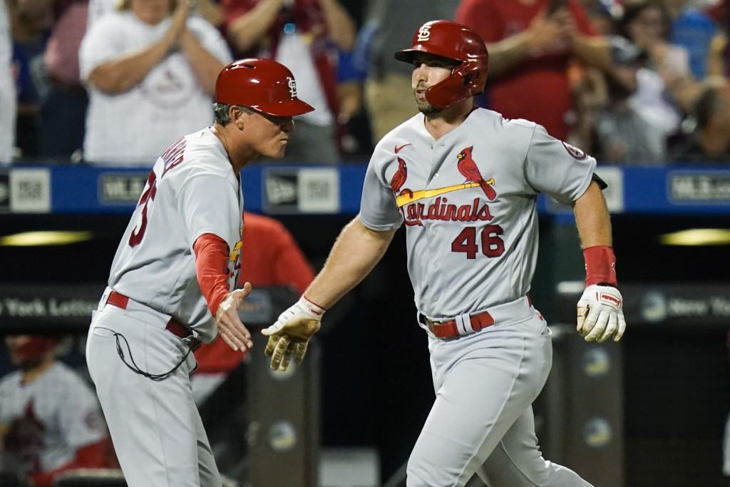 """St. Louis Cardinals' Paul Goldschmidt, right, celebrates with third base coach Ron """"Pop"""" Warner as he runs the bases after hitting a home run during t..."""