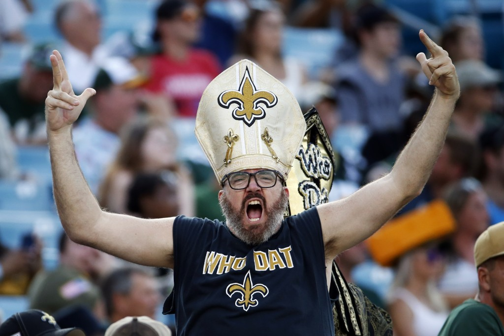 A New Orleans Saints fan cheers during the second half of an NFL football game between the New Orleans Saints and the Green Bay Packers, Sunday, Sept....