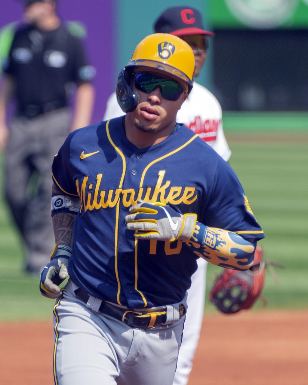 Milwaukee Brewers' Kolten Wong rounds the bases after hitting a home run off Cleveland Indians starting pitcher Aaron Civale during the first inning o...