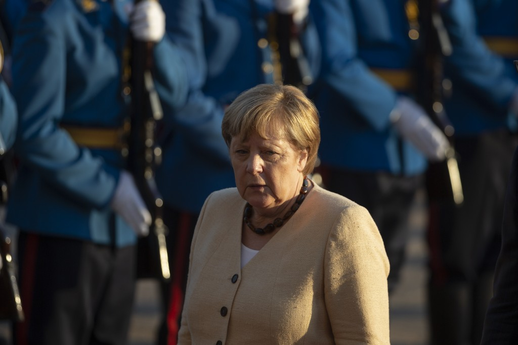 German Chancellor Angela Merkel walks past honor guards during her visit to Belgrade, Serbia, Monday, Sept. 13, 2021. Merkel is on a farewell tour of ...