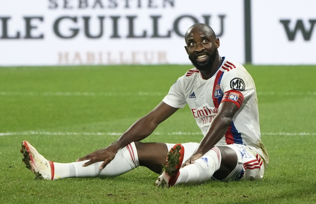 Lyon's Moussa Dembele reacts during the French League One soccer match between Strasbourg RCSA and Olympique Lyonnais at the Groupama stadium in Lyon,...