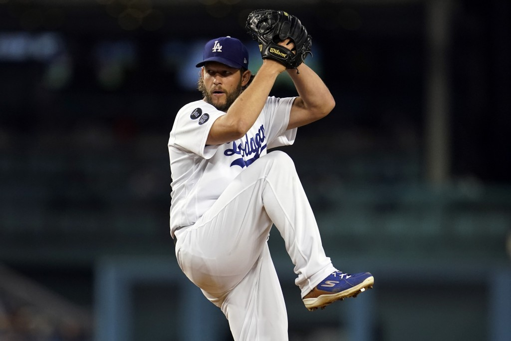 Los Angeles Dodgers starting pitcher Clayton Kershaw throws to an Arizona Diamondbacks batter during the first inning of a baseball game Monday, Sept....