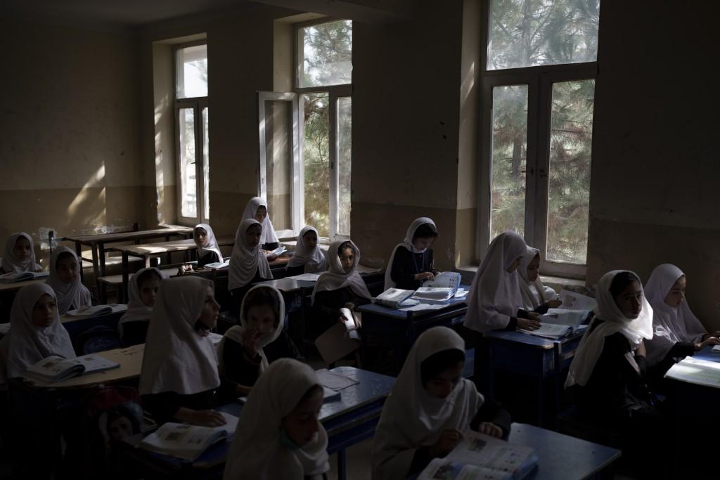 Girls prepare for class at a school in Kabul, Afghanistan, Sunday, Sept. 12, 2021. (AP Photo/Felipe Dana)