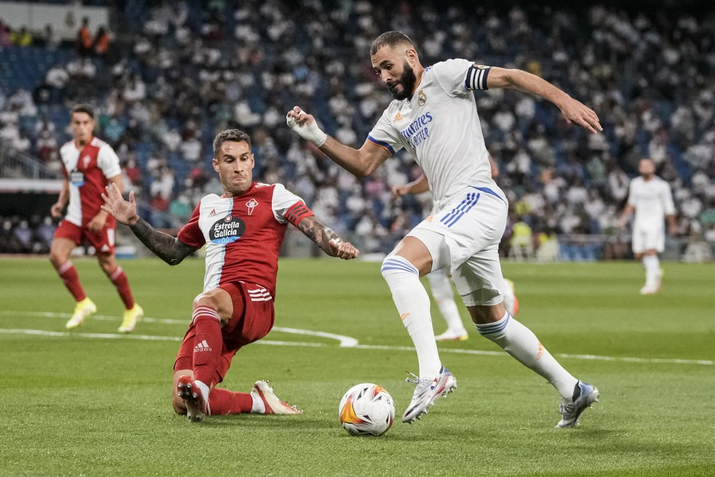 Real Madrid's Karim Benzema, right, vies for the ball during the Spanish La Liga soccer match between Real Madrid and Celta de Vigo at the Bernabeu st...