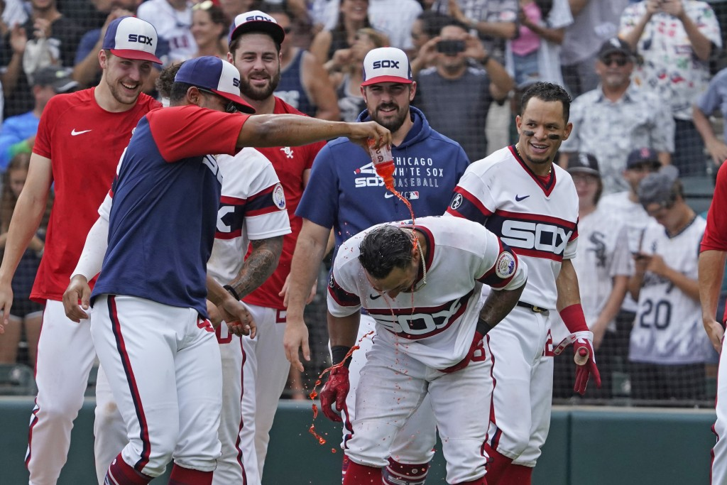 Chicago White Sox's Leury Garcia, center, gets douse with sports drink as the White Sox celebrates his walk-off home run during the ninth inning again...