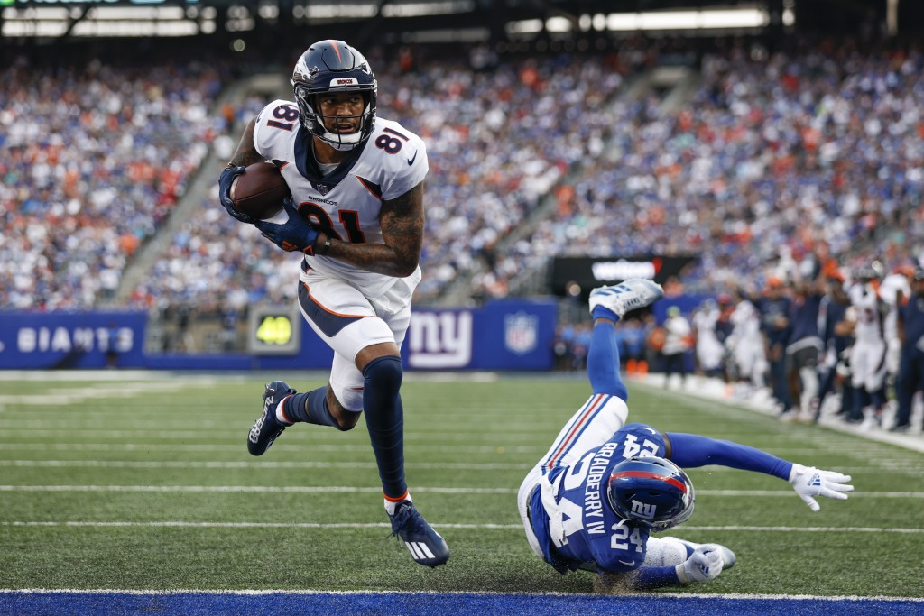 Denver Broncos' Tim Patrick (81) breaks a tackle by New York Giants' James Bradberry (24) to score a touchdown during the first half of an NFL footbal...