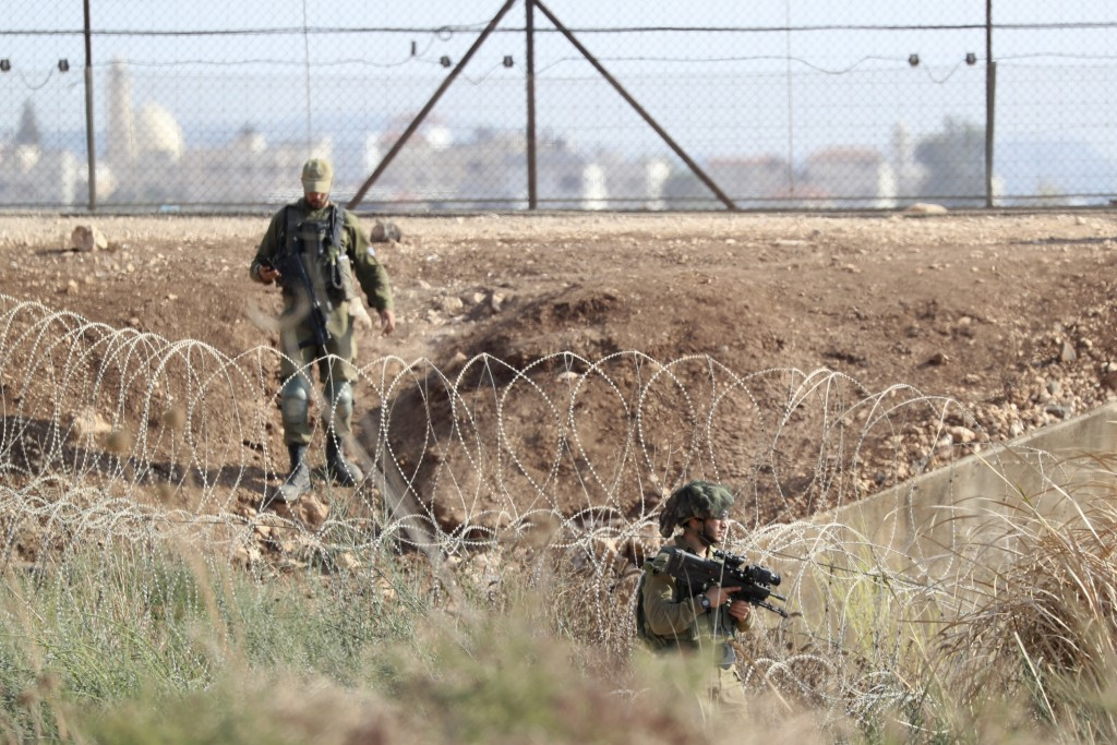 Israeli soldiers take positions along the border between the northern West Bank near Jenin and Israel as they search for two Palestinians who broke ou...