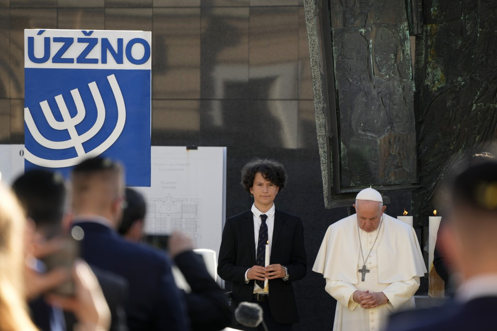 Pope Francis prays as he meets members of the Jewish community in Bratislava, Slovakia, Monday, Sept. 13, 2021. Ahead of a rigorous two days hop-scotc...