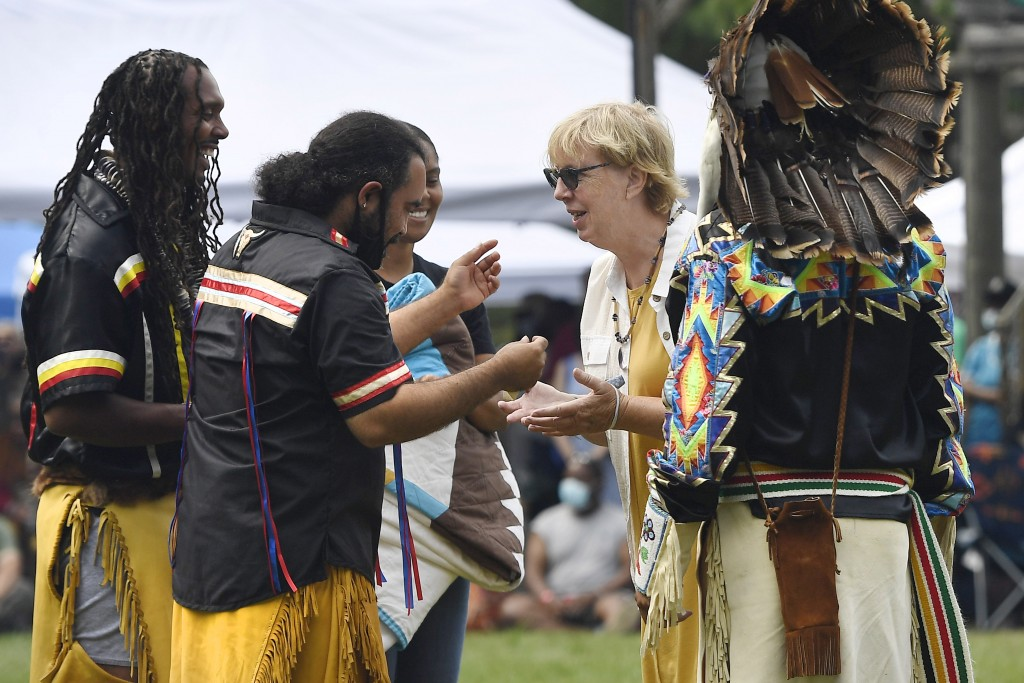 Connecticut State Sen. Cathy Osten, D-Sprauge, receives a necklace as a gift from representatives of the Pequot Nation for her support of Native Ameri...
