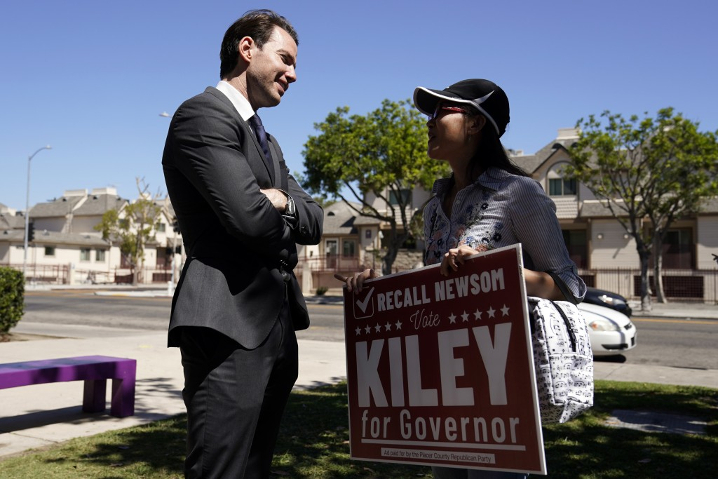 Assemblyman Kevin Kiley, left, of Rocklin, a Republican candidate for governor in the Sept. 14 recall election, speaks with supporter Nancy Jiang duri...