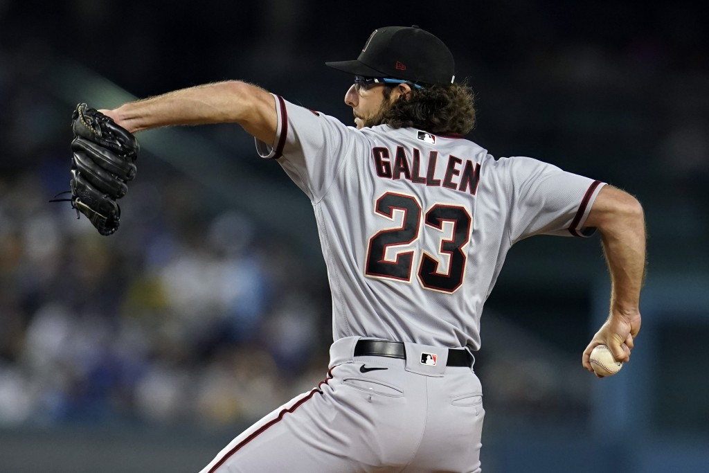 Arizona Diamondbacks starting pitcher Zac Gallen throws to a Los Angeles Dodgers batter during the first inning of a baseball game Monday, Sept. 13, 2...