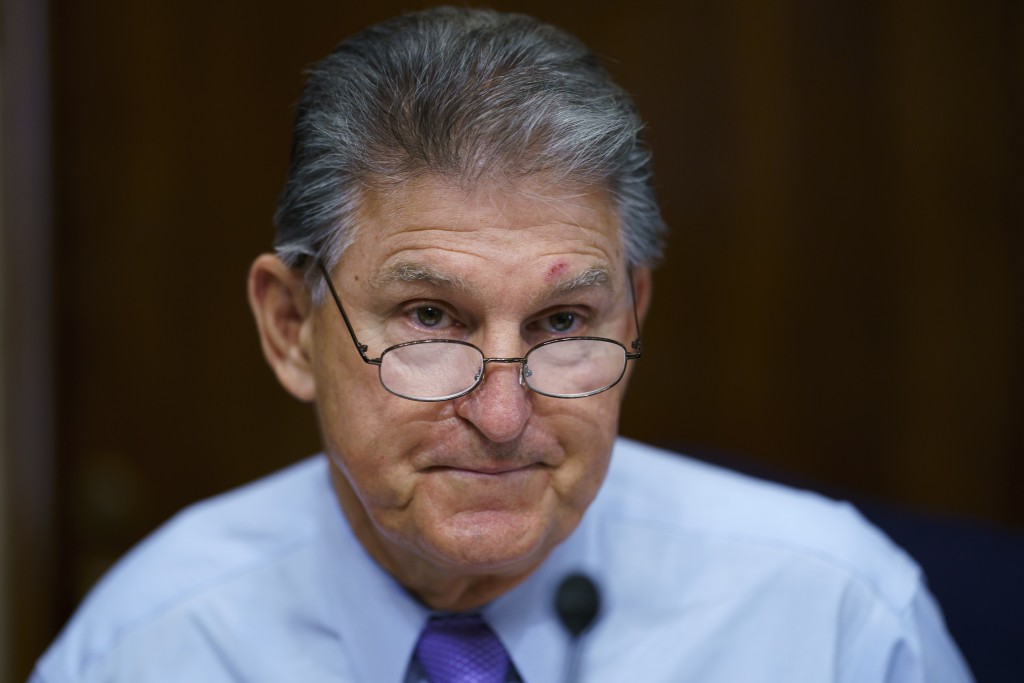 FILE - In this Aug. 5, 2021, file photo Sen. Joe Manchin, D-W.Va., prepares to chair a hearing in the Senate Energy and Natural Resources Committee, a...
