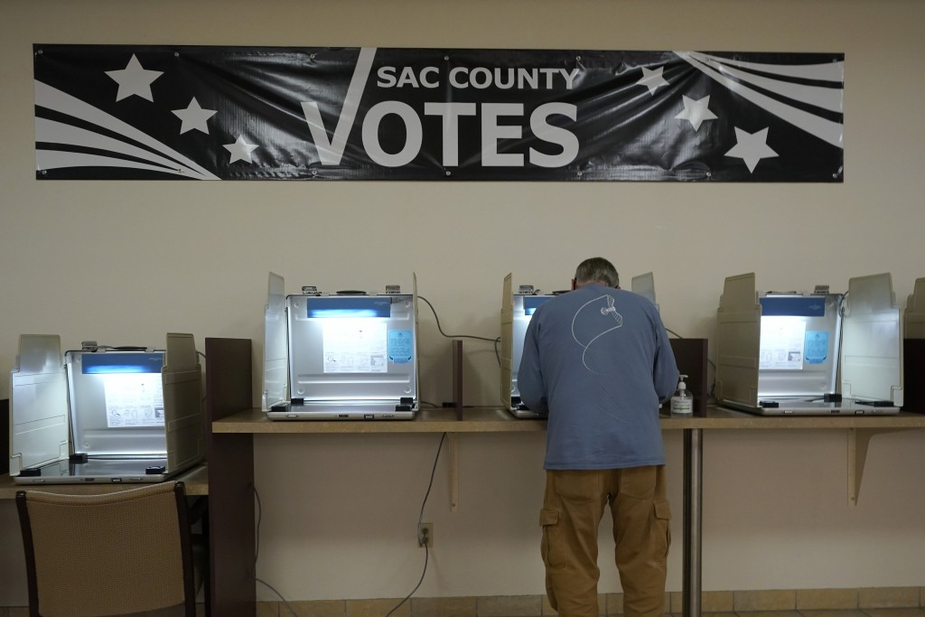 FILE — In this Aug. 16, 2021 file photo Donald Brown, marks his ballot for the Recall Election at the Sacramento County Registrar of Voters office in ...