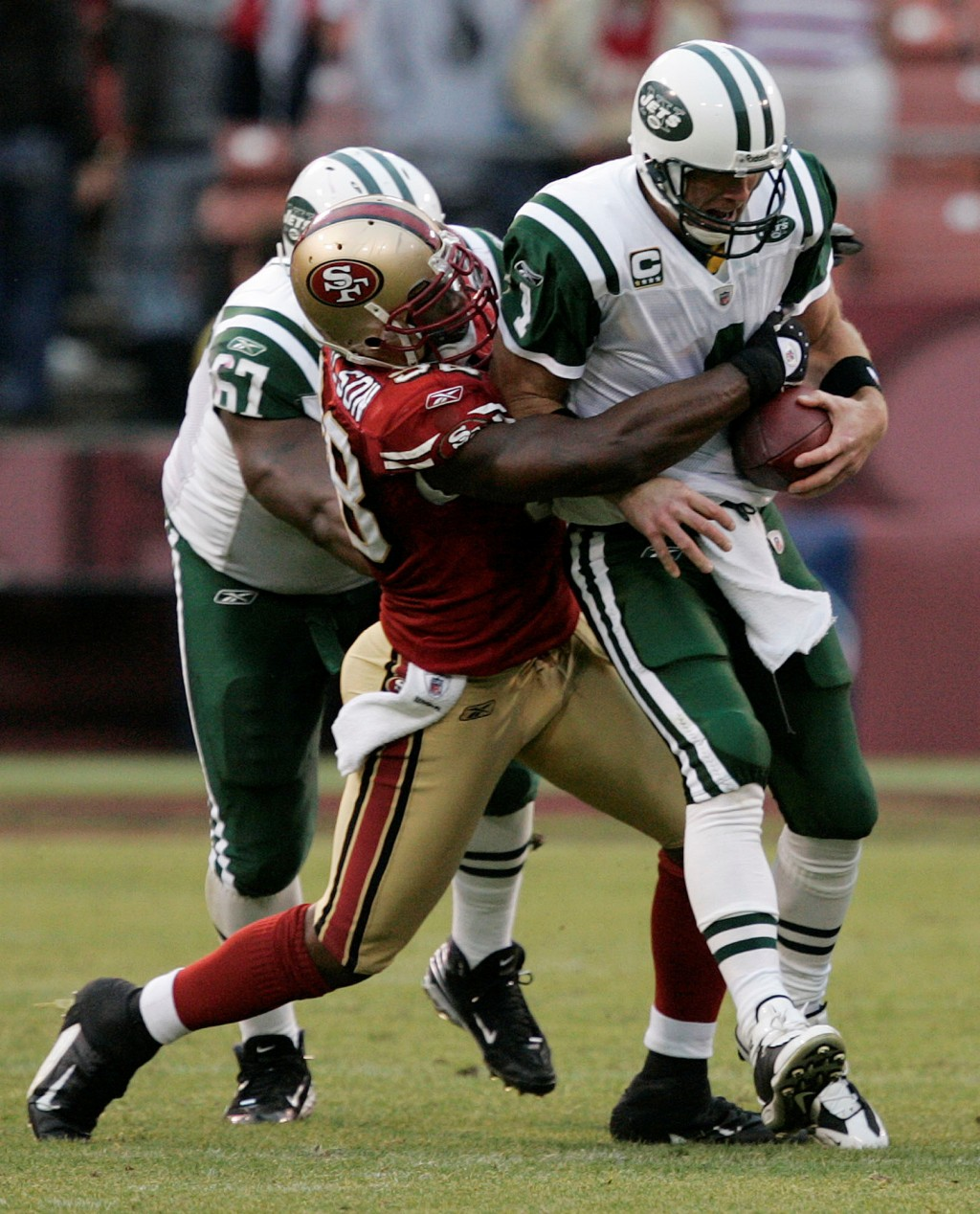 FILE - In this Sunday, Dec. 7, 2008, file photo, New York Jets quarterback Brett Favre is sacked by San Francisco 49ers linebacker Parys Haralson duri...