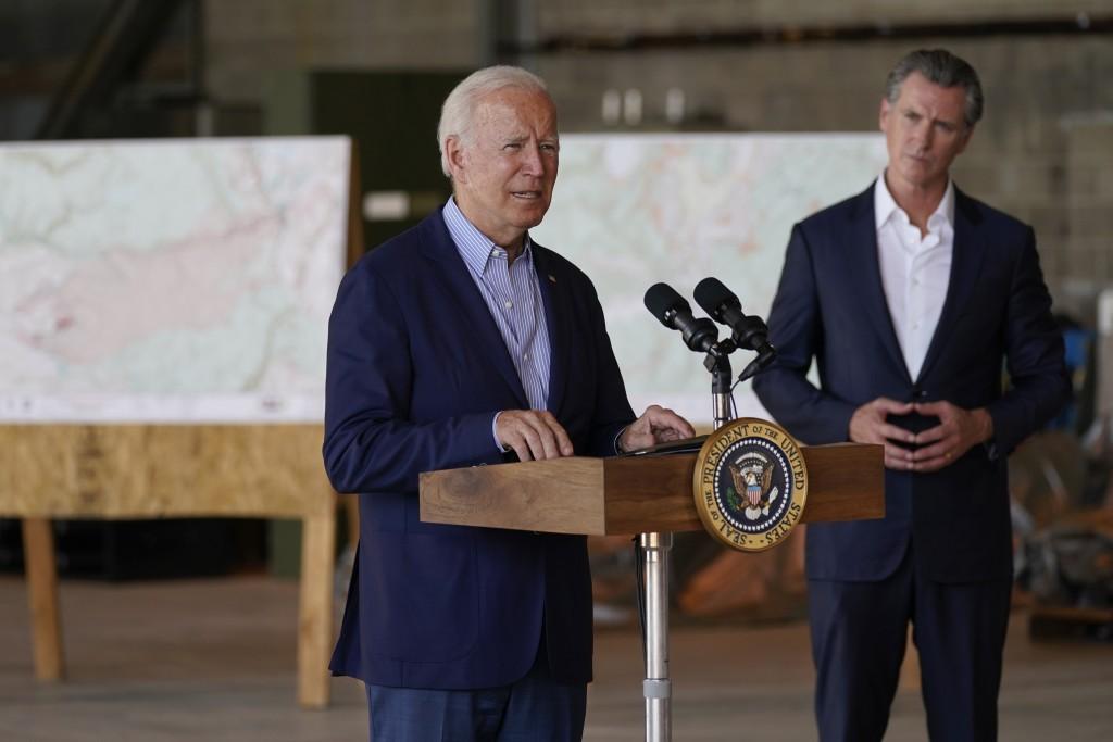 President Joe Biden speaks about recent wildfires, at Sacramento Mather Airport, Monday, Sept. 13, 2021, in Mather, Calif., as California Gov. Gavin N...