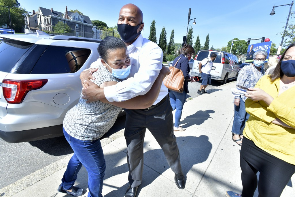 Mayoral Candidate John Barros greets supporter Arlette Santos of Boston outside a polling place in the Dorchester neighborhood of Boston on Tuesday, S...