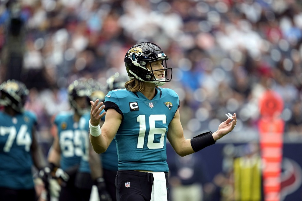 Jacksonville Jaguars quarterback Trevor Lawrence (16) reacts after a penalty called against the offense during the first half of an NFL football game ...