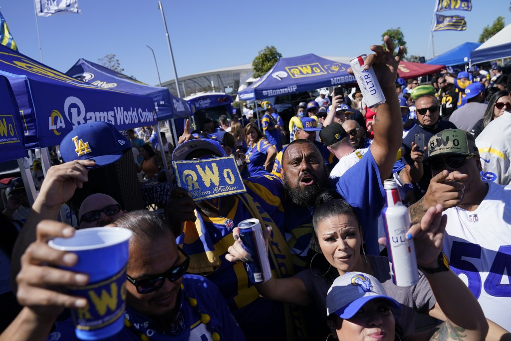 Fans for the Los Angeles Rams and the Chicago Bears tailgate before an NFL football game at SoFi Stadium Sunday, Sept. 12, 2021, in Inglewood, Calif. ...