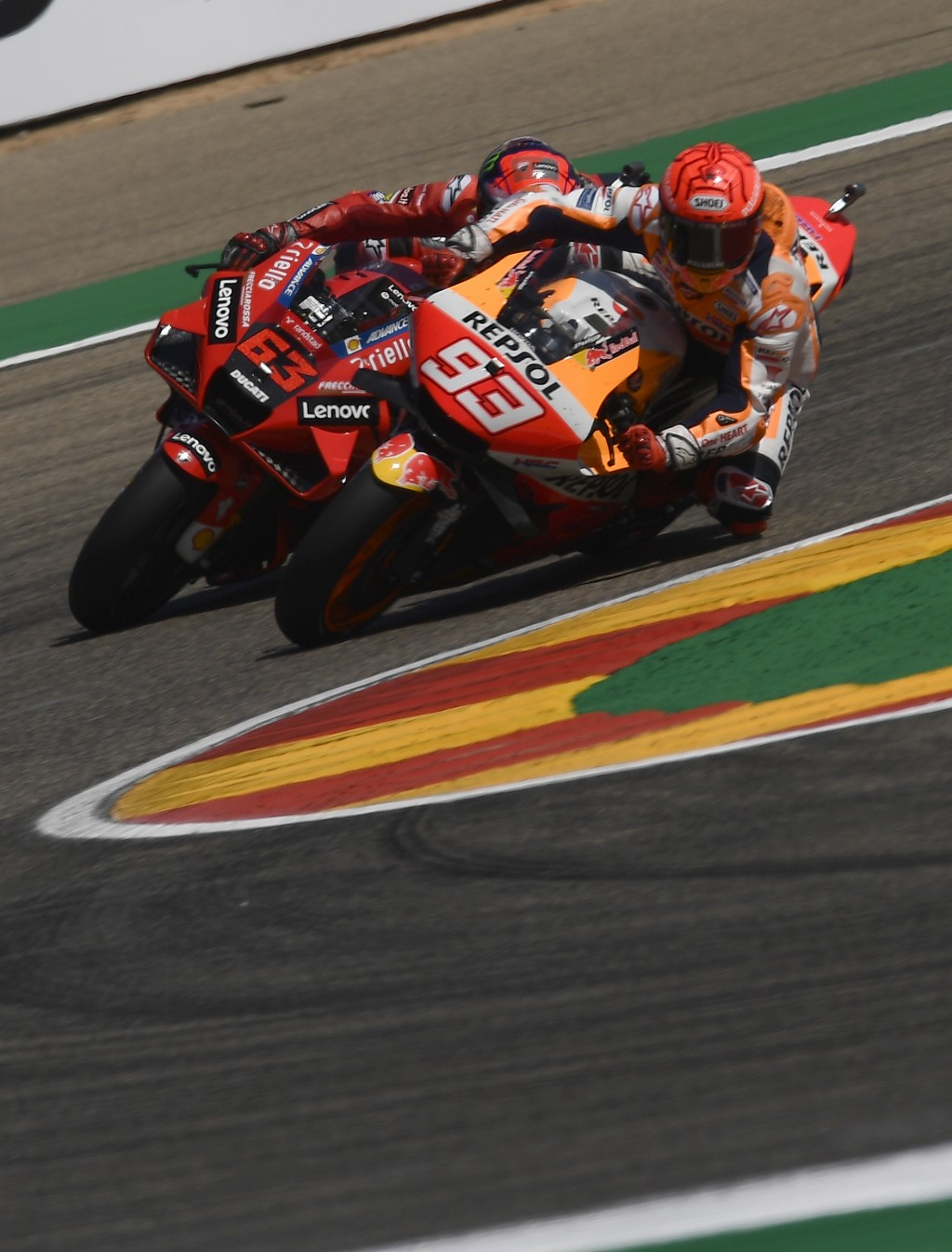 Marc Marquez of Spain, (93), briefly leads Francesco Bagnaia of Italy during the Alcaniz Aragon Moto GP race at the MotorLand Aragon circuit, in Alcan...