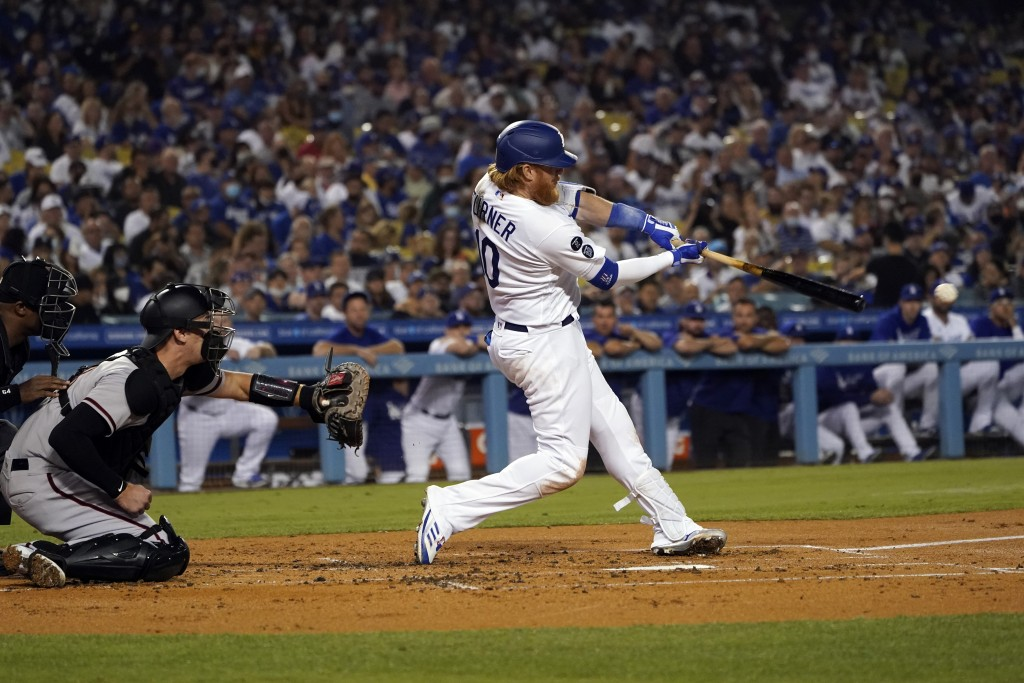 Los Angeles Dodgers' Justin Turner drives in two-runs with a double during the first inning of a baseball game against the Arizona Diamondbacks Monday...
