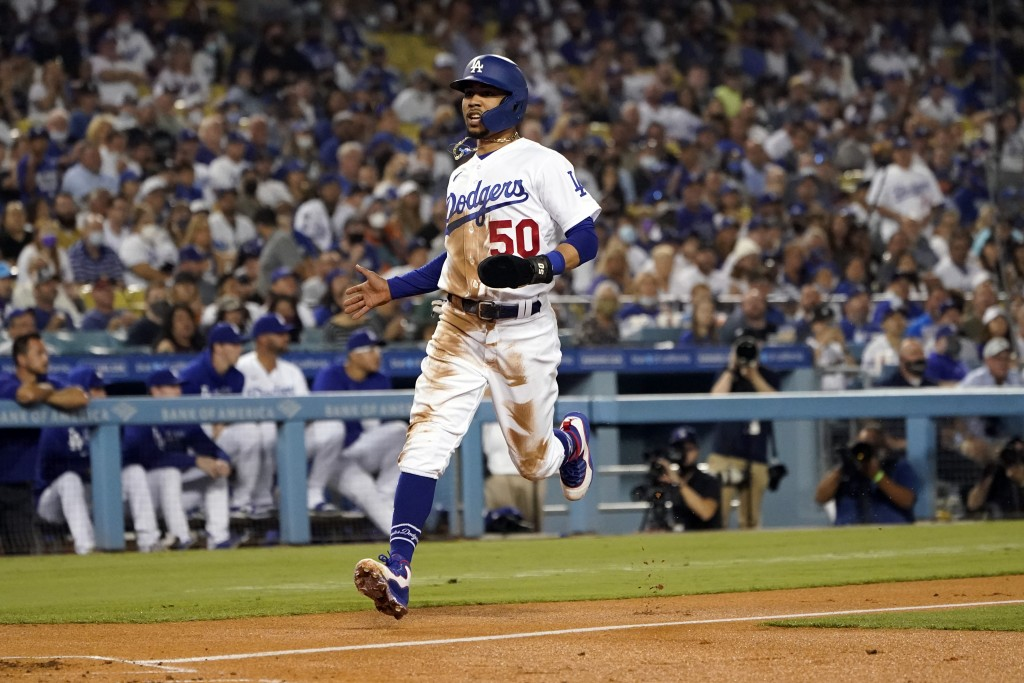 Los Angeles Dodgers' Mookie Betts scores on a single from Corey Seager during the first inning of a baseball game against the Arizona Diamondbacks Mon...
