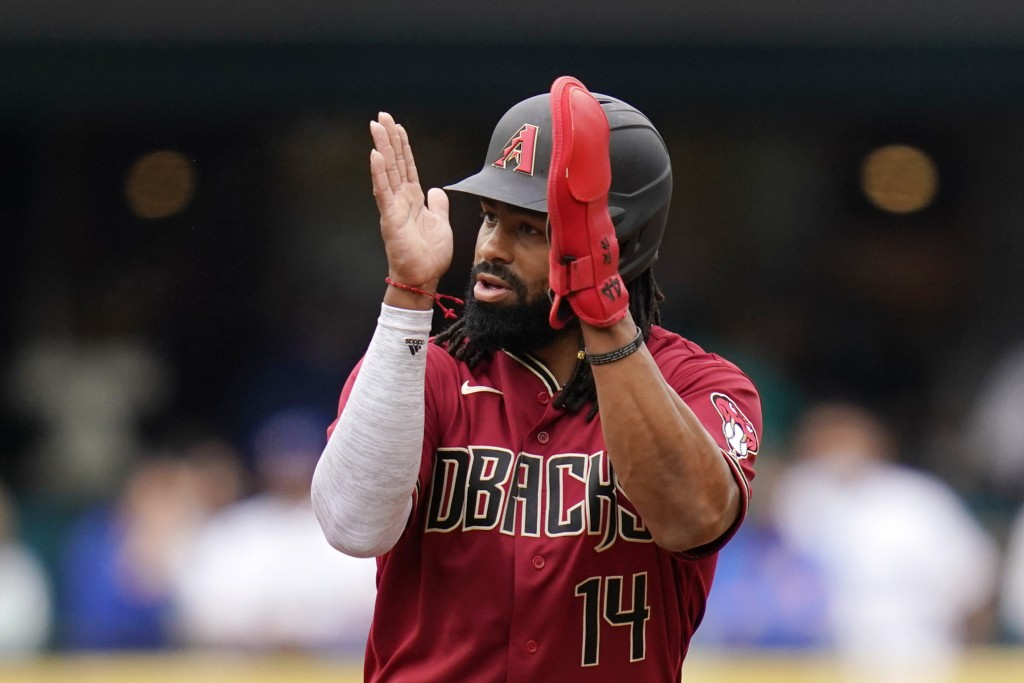 Arizona Diamondbacks' Henry Ramos applauds play as he leads off second base after his two-run double against the Seattle Mariners in the sixth inning ...