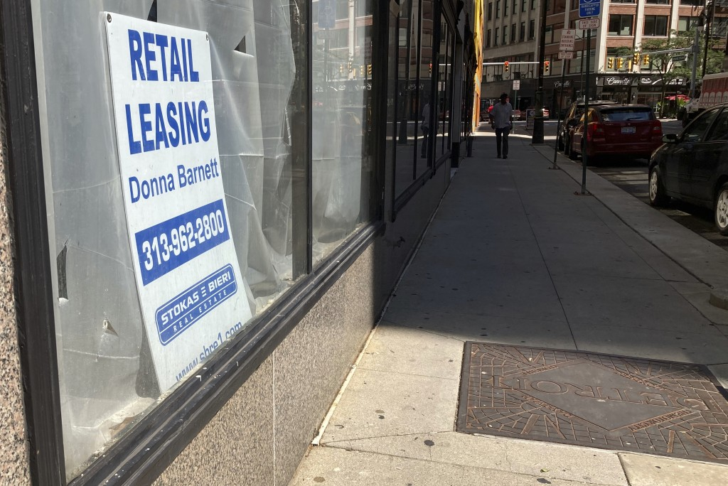 A sign in a window advertises retail leasing in Detroit, Sept. 2, 2021. Downtown businesses that once took for granted an office-worker clientele have...