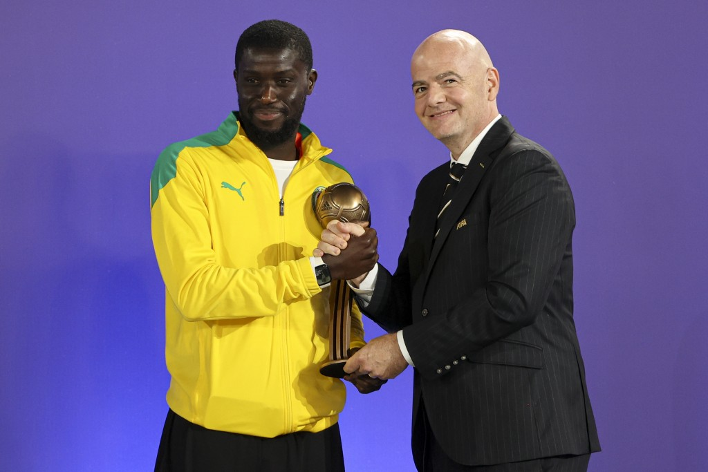 FIFA President Gianni Infantino, right, poses for a photo with Senegal's Amar Samb during an awarding ceremony at the FIFA World Beach Soccer Champion...