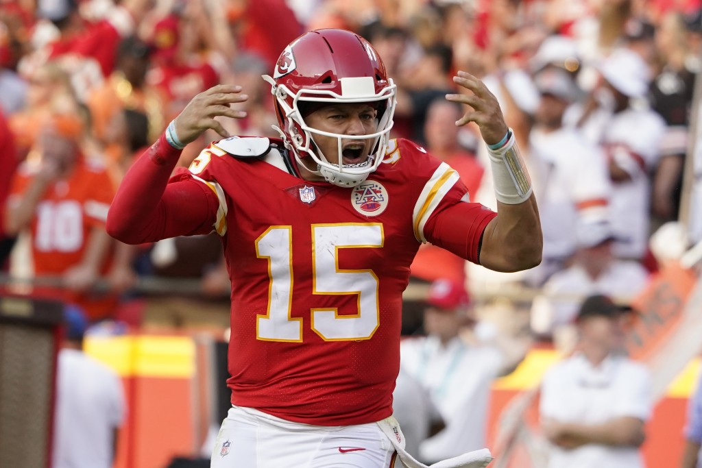 Kansas City Chiefs quarterback Patrick Mahomes celebrates after throwing a touchdown pass during the second half of an NFL football game against the C...
