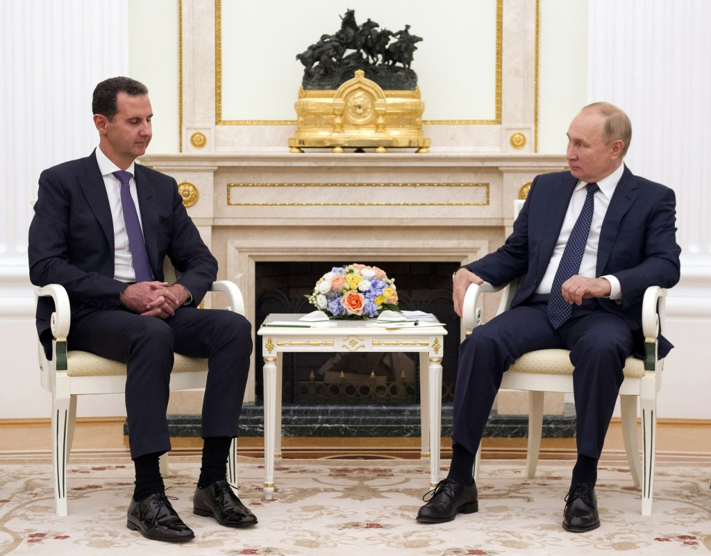 Russian President Vladimir Putin, right, listens to Syrian President Bashar Assad during their meeting in the Kremlin in Moscow, Russia, Monday, Sept....
