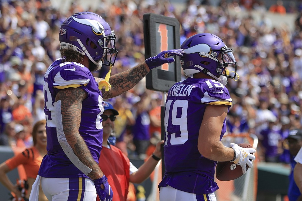 Minnesota Vikings wide receiver Adam Thielen (19) is greeted by tight end Tyler Conklin (83) after he made a catch for a touchdown against the Cincinn...