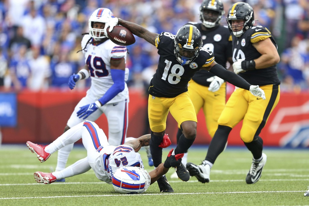 Pittsburgh Steelers wide receiver Diontae Johnson (18) is tackled by Buffalo Bills cornerback Taron Johnson (24) during the second half of an NFL foot...
